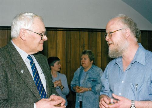 Prof Charlie Ellington talking to R E D Holder at a retirement party